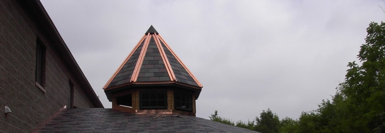 Whole View Of Synthetic Slate And Copper Roof